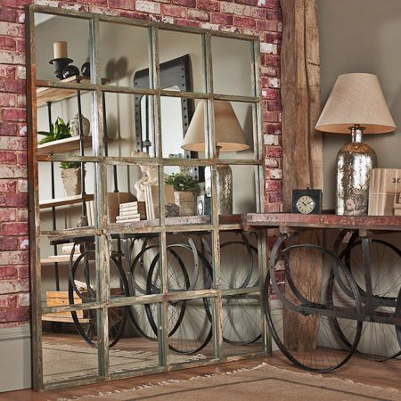 As the name suggests this huge mirror is in the style of an old factory window Made from box tube steel and finished with a brilliantly aged paint