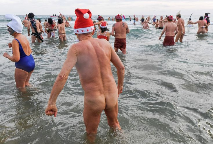 People take part in a traditional skinny dip to mark the end of the year, in Le Cap d'Agde, France. (Pascal Guyot / AFP / Getty Images) https://pow.photos/2018/international-pow-26-december-1-january/