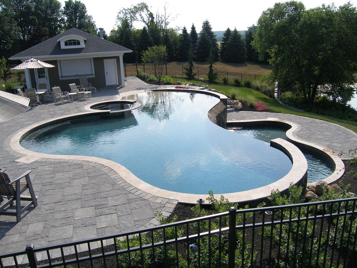 Freeform Gunite Pool With Spill Over Spa Beach Entry And