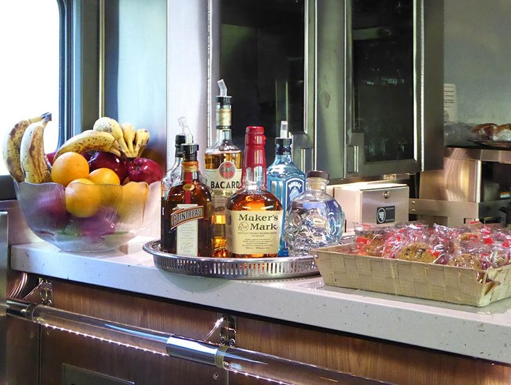 Canada by rail: on board The Canadian train, by Janet Podolak -   The bar in the Prestige car at the rear of the Canadian has premium liquors and a variety of wines. The lounge and other Prestige cars are open to other passengers in late afternoon.