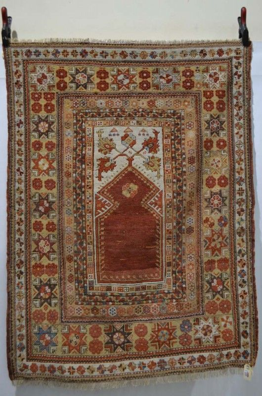 Melas prayer rug, west Anatolia, first half 19th century, 4ft. 11in. x 3ft. 8in. 1.50m. x 1.12m.