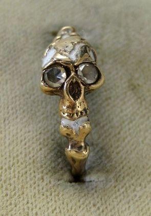 Ring - Memento Mori Diamond set Skull/Bone. Love how people used to set baby teeth in jewelry. Maybe my mom saved one of mine