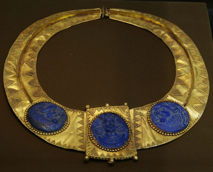 Gold necklace, with king and flanking lions in carved lapis lazuli; Sassanian period, 5th - 6th century A.D. In the collection of the Reza Abbasi Museum, Tehran.