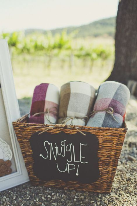 "Provide guests with warm blankets on cooler days or if the party carries on into the night. Add ""snuggle up"" or another personal message to the basket."