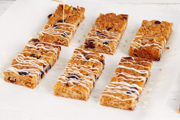 Combine oats, cranberries, coconut and other delicious goodies to make satisfying muesli bars.