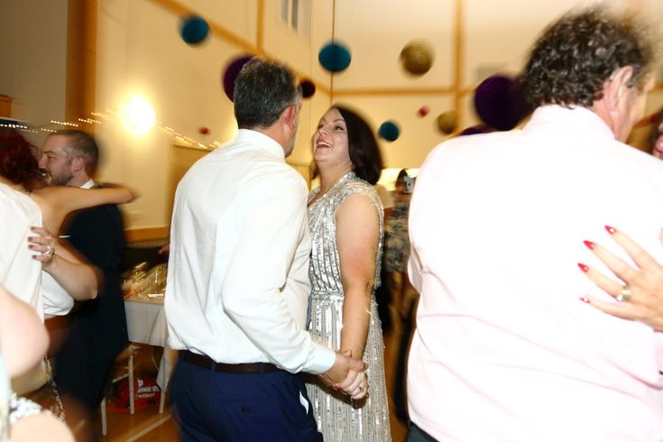 fun couple dancing at manuden village hall, alternative essex wedding photography