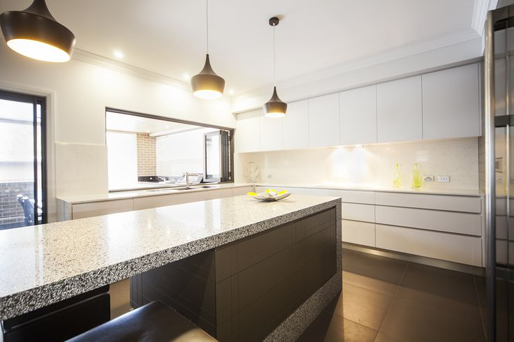 Large windows in the kitchen allow for excellent lighting and open the kitchen up into the outdoor entertaining area!