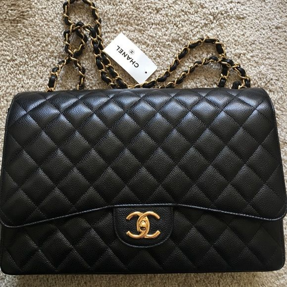 New Chanel classic double flap Maxi Caviar gold Brand new with tag. Plus a receipt (dated 5/16/2011) With original box, black dust bag, authentic card starts with 147(8digits in total). Double flap with wine color lining. Please let me know your email for additional pics. Sorry I am not into trading. Serious inquiries only. CHANEL Bags Shoulder Bags