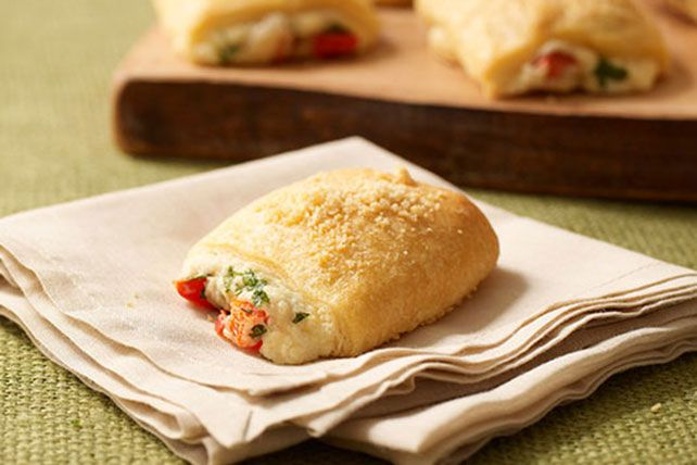 The fresh parsley and ripe red pepper in these warm and toasty Parmesan bundles dial up the flavor in every bite.