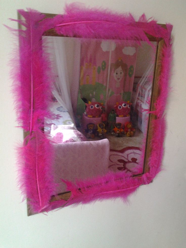 Jazz up an old mirror with some bright feathers xxx