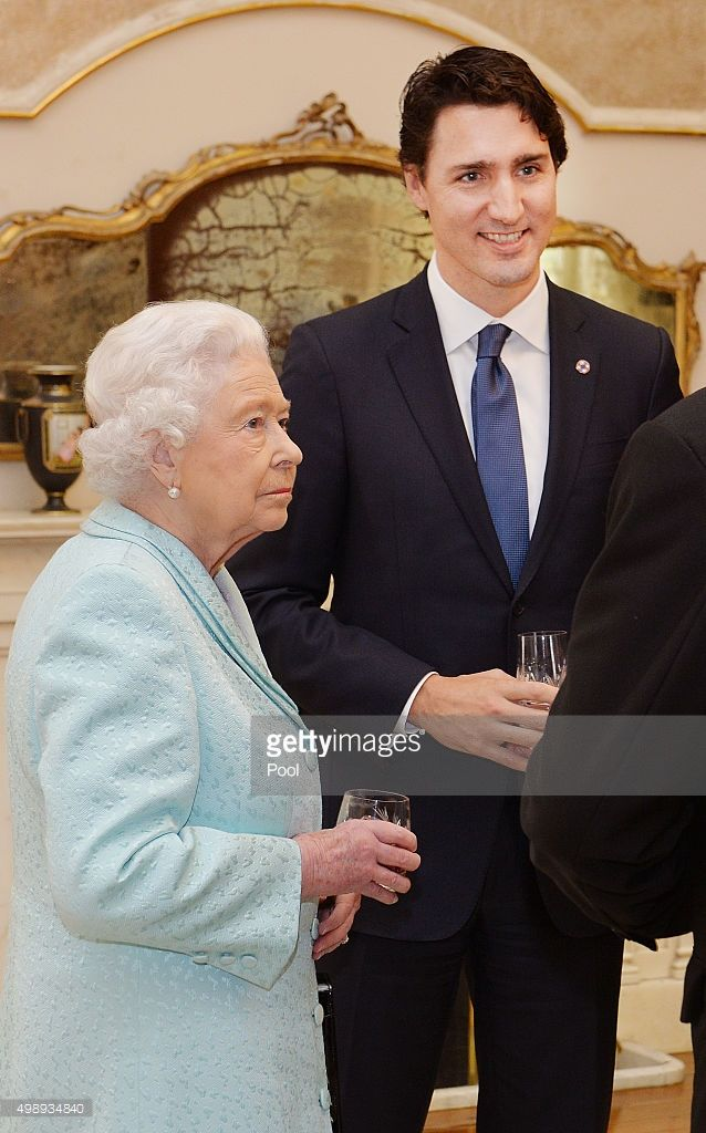 Queen Elizabeth II talks to the Prime Minister of Canada Justin Trudeau during a Heads of Government reception at the San Anton Palace on November 27, 2015 near Attard, Malta. Queen Elizabeth II, The Duke of Edinburgh, Prince Charles, Prince of Wales and Camilla, Duchess of Cornwall arrived yesterday to attend the Commonwealth Heads of State Summit.