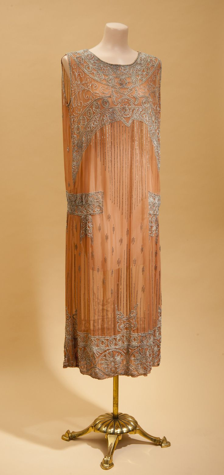 Evening dress, ca. mid-1920s. Oriental influence is unmistakable in both choice of cloth(silk/satin) and motifs.