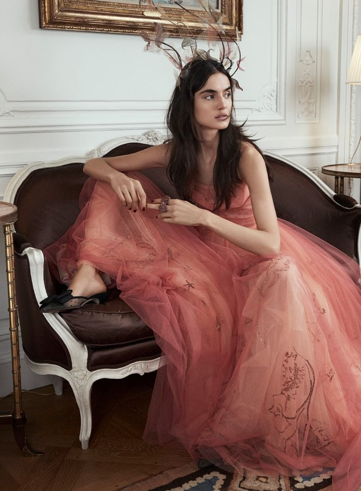 Top model Blanca Padilla graces the pages of Vanity Fair Spain's June 2017 issue. Photographed by Alex Bramall, the brunette stunner poses at Dior's headquarters in Paris. Blanca charms in complete looks from Dior Haute Couture's spring collection. Stylist Carla Aguilar outfits the leggy beauty in tulle gowns, feathered headpieces and gilded embellishments. For beauty, …