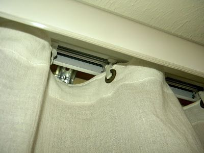How to Update Your Vertical Blinds with sheets and eyelets for the vertical blinds track...awesome.