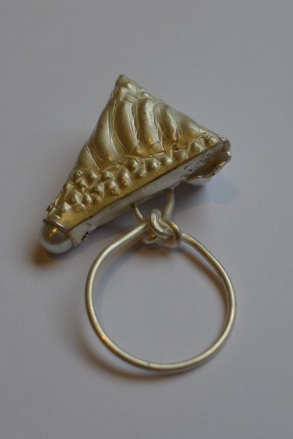 Octavia Cook, Freshwater Dalliance Ring, 2013. Octavia says, I have used the repousse technique to create a crocodile skin texture on the silver, that I then folded and riveted a pearl into. The ring shank is knotted like a pearl string.