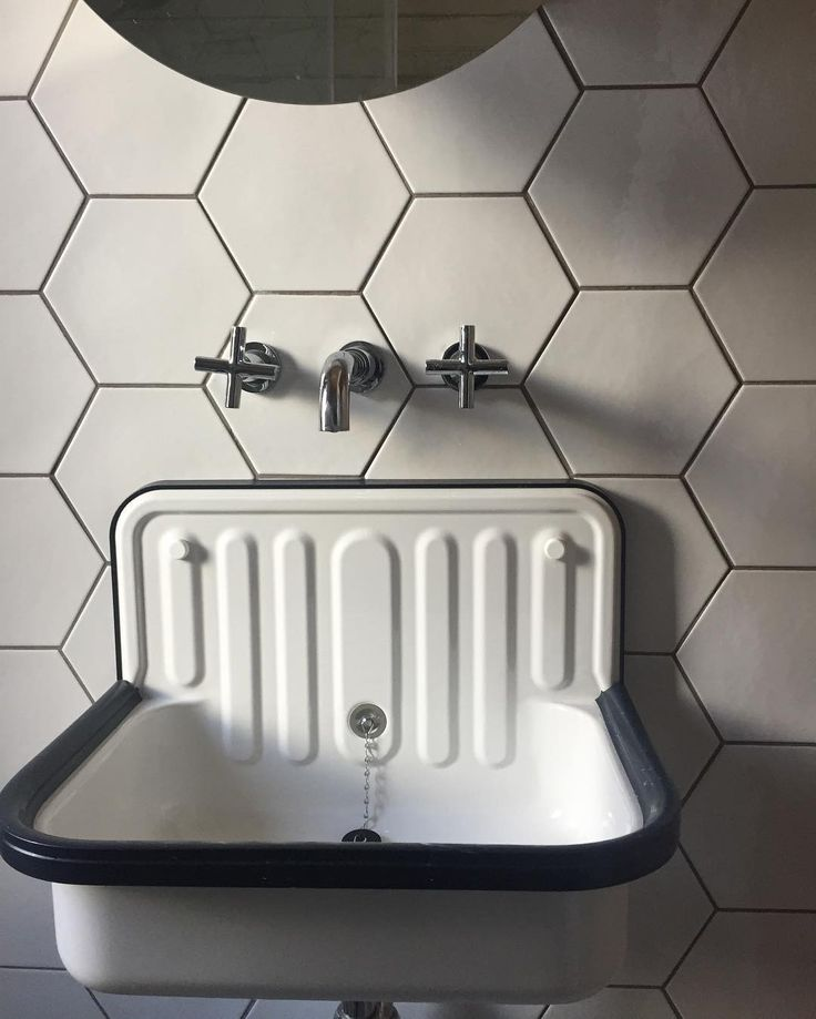 Bucket sink. Sink. Laundry room design. Backsplash. Hexagon tile. Alape bucket sink. Rejuvenation sink. White sink. White bathroom. Bathroom sink. Industrial chic. Industrial inspired.