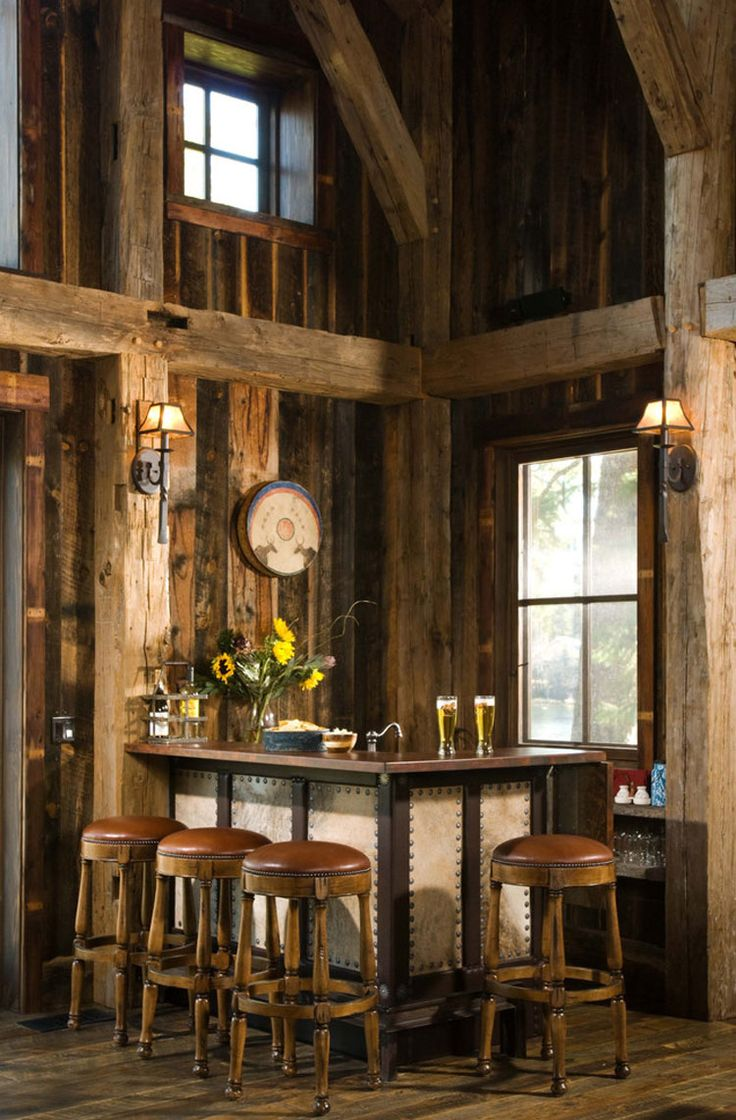 Rustic Bar With Exposed Beam, Wall Sconce, Hardwood Floors, High Ceiling,  Columns
