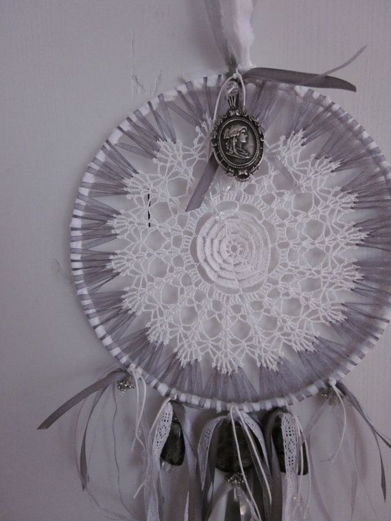 A vintage lace doily dream catcher in white and gray by SierGoed