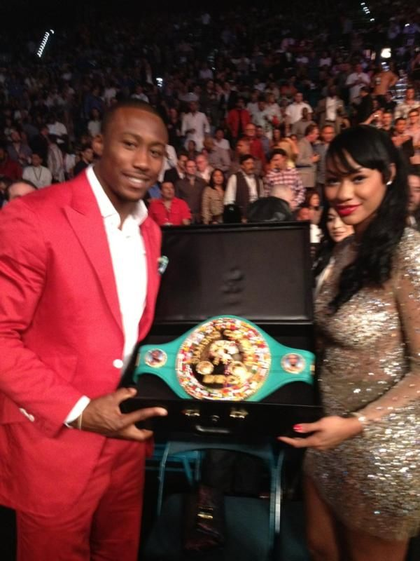 Brandon Marshall And Wife Hold The Belt