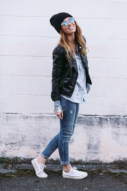 black leather biker jacket, light blue denim shirt, blue tight jeans, white canvas low sneakers for lady