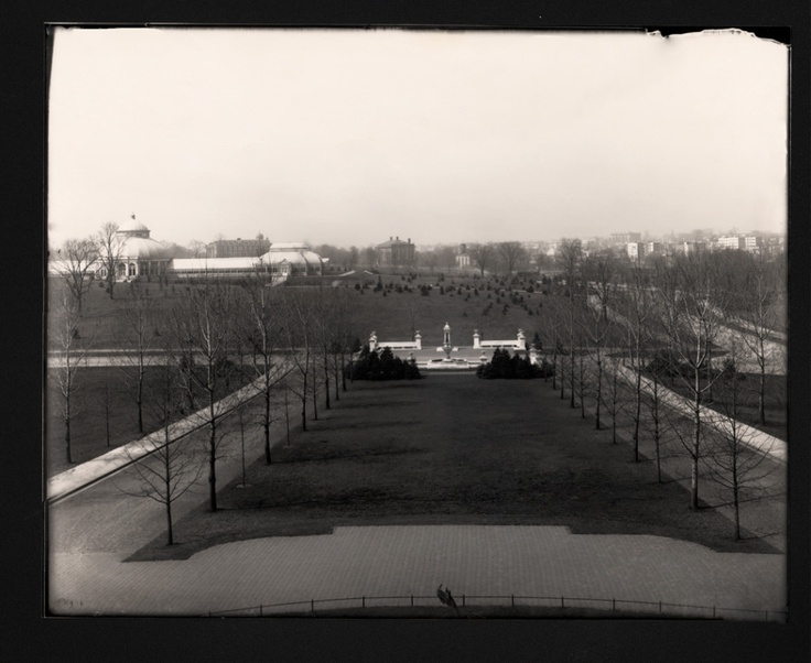 From an early-20th-century photograph, a view of the Garden from atop the Library Building with neighboring Fordham University in the distance.    (Source: The New York Botanical Garden's historical photographs, in the collections of The LuEsther T. Mertz Library.)