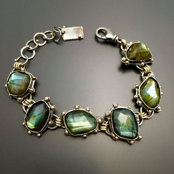 Sterling Silver 14K Gold Labradorite Bracelet Handmade Wild Prairie Silver Jewelry Gorgeous faceted Labradorite stones glow with each turn in the light, their beautiful color changing blue/green. 14K gold accents each stone, three 14k gold rings connect each stone... even the handmade links on the extension links of the bracelet are decorated with a drop of gold. Bracelet will fit 6.5-8 wrist but I can make it fit any wrist. I have two extra links completed and can always remove a link as…