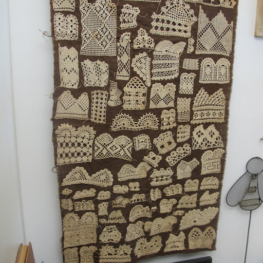 Vintage crochet sampler from the late 19th century as a wall hanging.