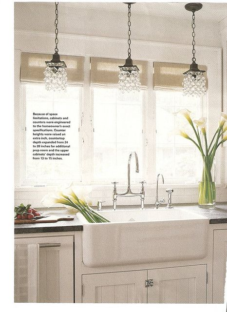 White Kitchen inspiration | Spacious, with farm sink and an abundance of natural lighting