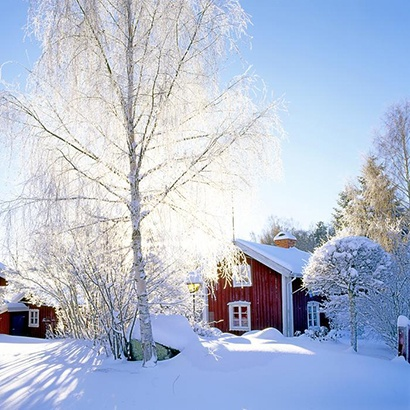 The typical Swedish red wooden cottages are at their best when embedded in snow.