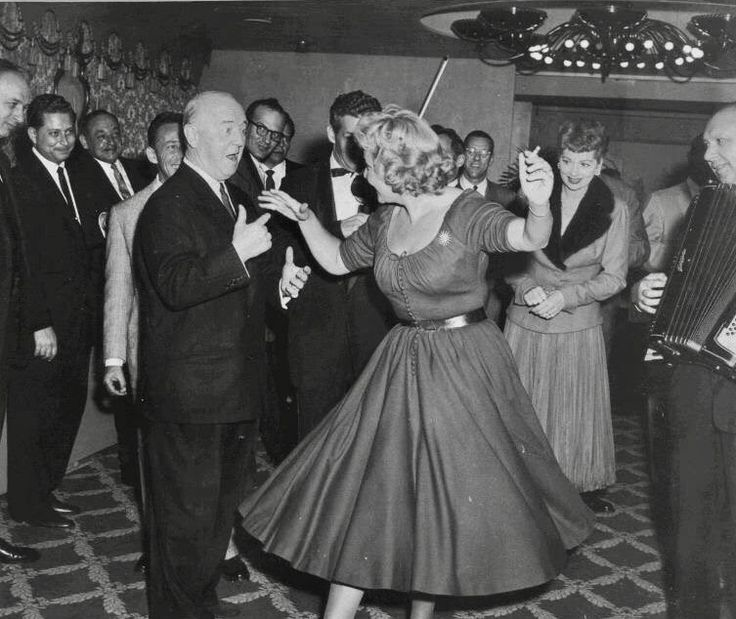 William Frawley and Vivian Vance dancing, with Lucille Ball looking on.