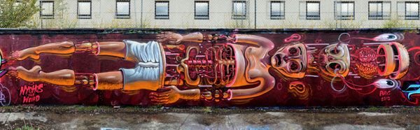 Nychos who often paints sectioned and dissected creatures, has dropped another lengthy wall on the streets of Clichy, France. This time around the artist used a simple figure of a human, stretched and pieced apart.