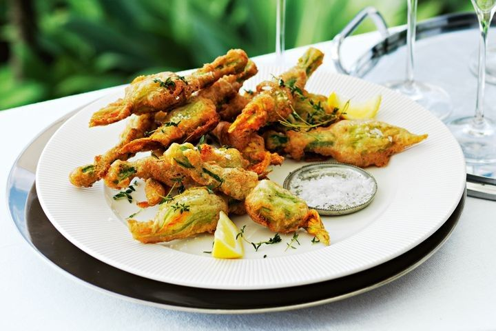 Champagne-battered zucchini flowers with cheese