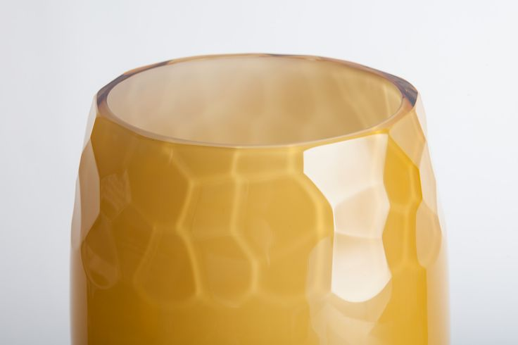 This is the first realization of my recent project. It's a vase for flowers but also an interior object. I experimented with amber glass and cutted structure.   This project was realized with ASTERA company.   www.astera-glass.cz
