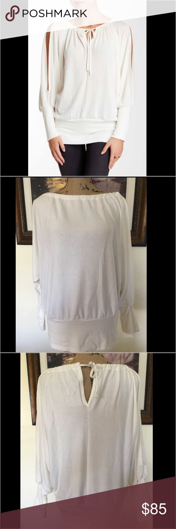 Go Couture Cold Shoulder Cream Sweater Go Couture Cold Shoulder Cream Sweater.  New without tags.   Soft, Fashionable and comfortable. Go Couture Sweaters