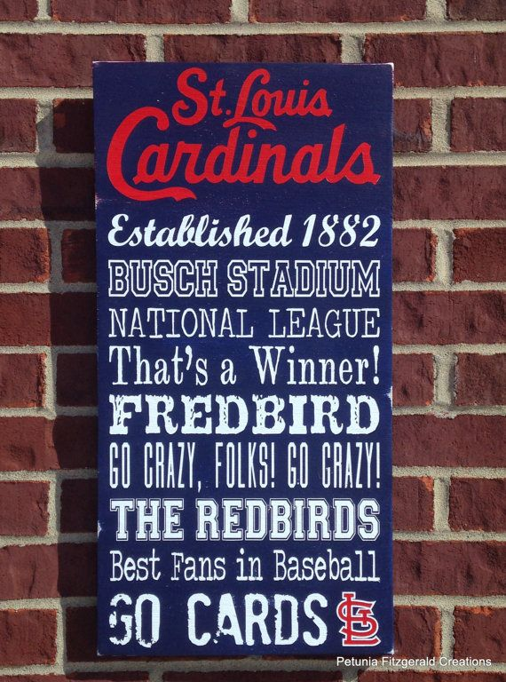 St. Louis Cardinals word art painted wood sign.    A painted board with an array of phrases pertaining to the St. Louis Cardinals. If you have