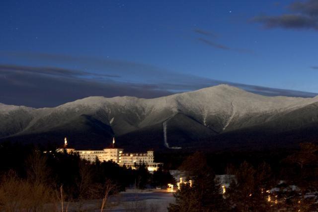 Go Climb New Hampshire's 48 4,000-Foot Mountains: The Mount Washington Hotel glows below Mount Washington, New Hampshire's highest mountain.