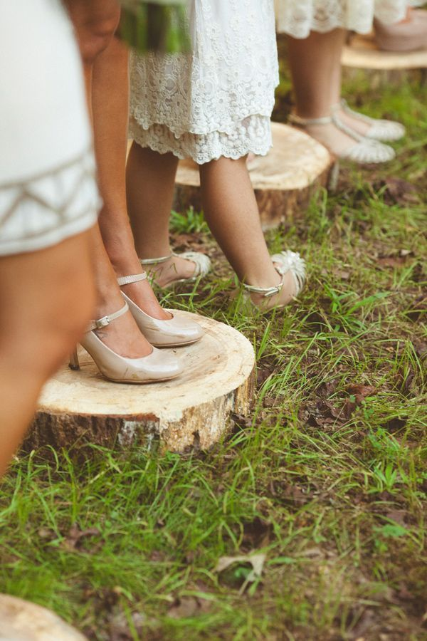 have bridesmaids stand on wood slices so their heels don't sink! photo by Kelly Maughan Photography http://ruffledblog.com/north-carolina-wedding-sourced-from-antique-shops #weddingideas