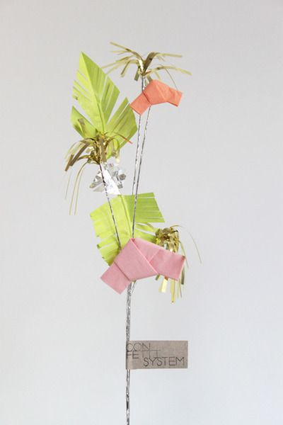Love this stand alone deco by confetti system. The palm tree looking leaf would be perfect for a destination wedding, plus I'm sure I could make this myself!