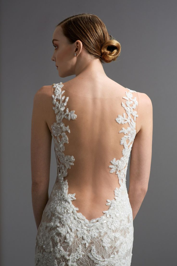 Watters - Cinzia.  Beautiful beaded lace over nude silk, a dramatically low, laced edge back and a figure hugging silhouette with dreamy tulle train.