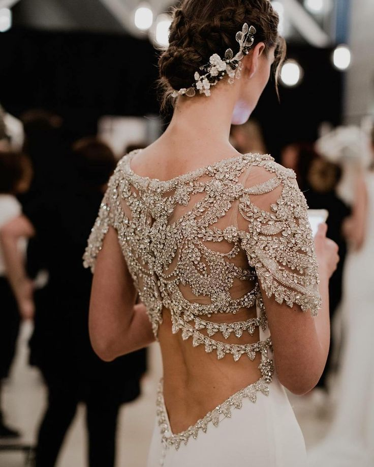 Ornate details are one of our favourite bridal trends of the moment, as seen here backstage at #pronovias #atelierpronovias2018. | Photography By: Charlotte Van Den Berg Photography | WedLuxe Magazine | #WedLuxe #Wedding #luxury #weddinginspiration #luxurywedding #fashion #weddingdress