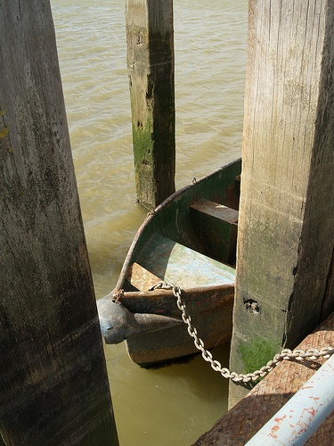 Boat chained up at the jetty on Ship Lane [shared]
