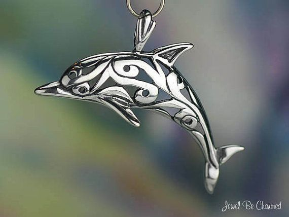 This sterling silver pendant shows a lovely dolphin featuring an open scrollwork design. It would be a wonderful gift idea for anyone who loves