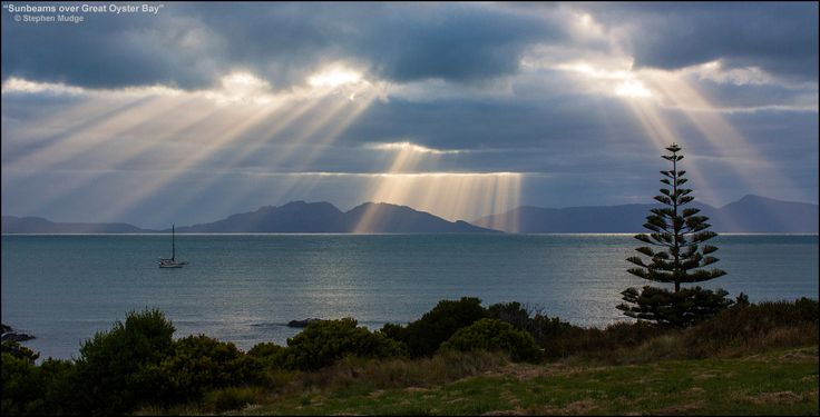 This photo captures some beautiful sunbeams over Great Oyster Bay, in Swansea, Tasmania, Australia.