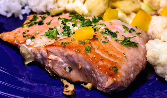 Grilled Salmon and Veggies by Wayne Wong on Capture Kern County // My wife brought home some great looking salmon and decided to grill it in a cast iron pan for a delicious presentation: grilled cauliflower, diced yellow peppers, garlic, with parsley garnish and  steamed rice.  Flickr image