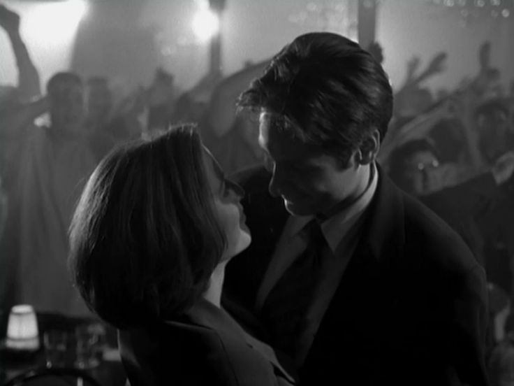 "Classic Romantic Moment of the Week: Scully and Mulder from The Post-Modern Prometheus when they dance to Cher's version of ""Walking in Memphis."" Did everyone know there's a deleted kiss in this scene?"