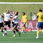 Anja Mittag of Germany celebrates with team mates