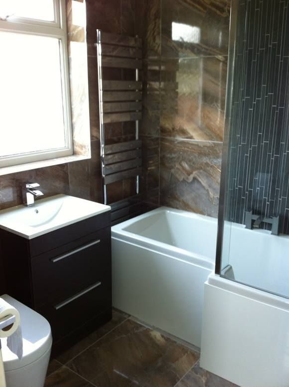 A bathroom wall and floor fitted with 60x60 Grand Canyon Copper; a larger  tile can