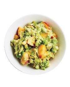 Easiest Peach-and-Avocado Guacamole! Lightly mash 2 avocados in a bowl. Stir in 1 ripe peach, season with salt, and serve immediately.
