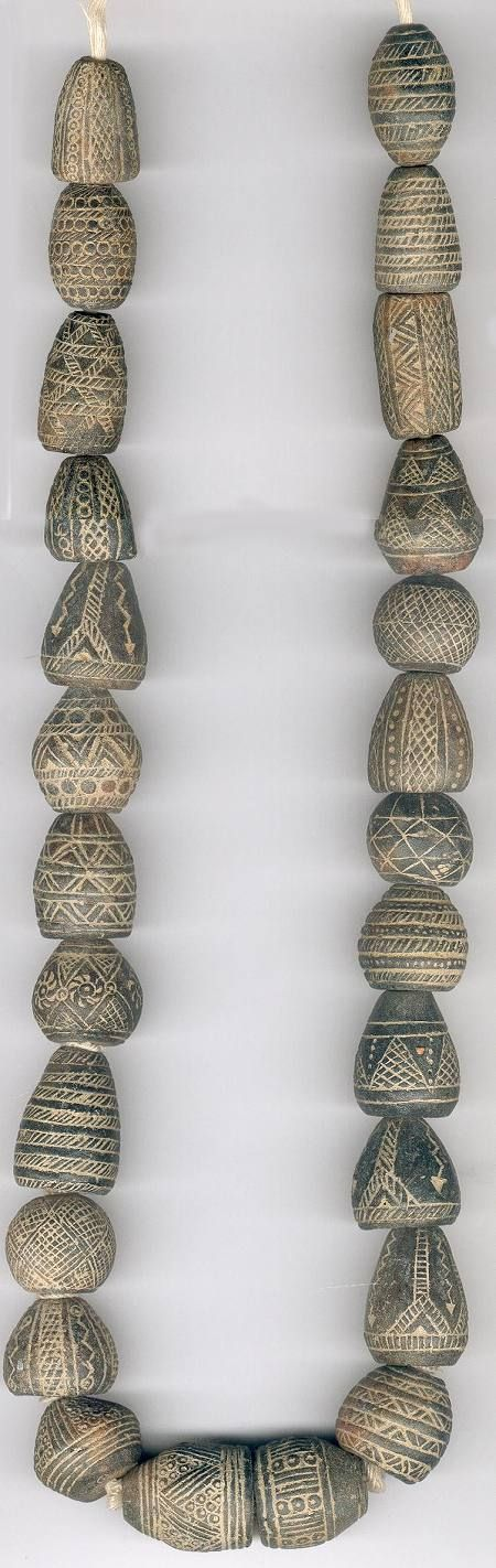 alaaddinsmagiclamp: african beads : clay spindle whorls - Mali A beautiful strand of Whorls from Malishowing some considerable artistry in their decoration.