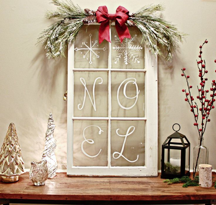 I love the look of a vintage Christmas so what better to decorate our console table than an old windowpane?